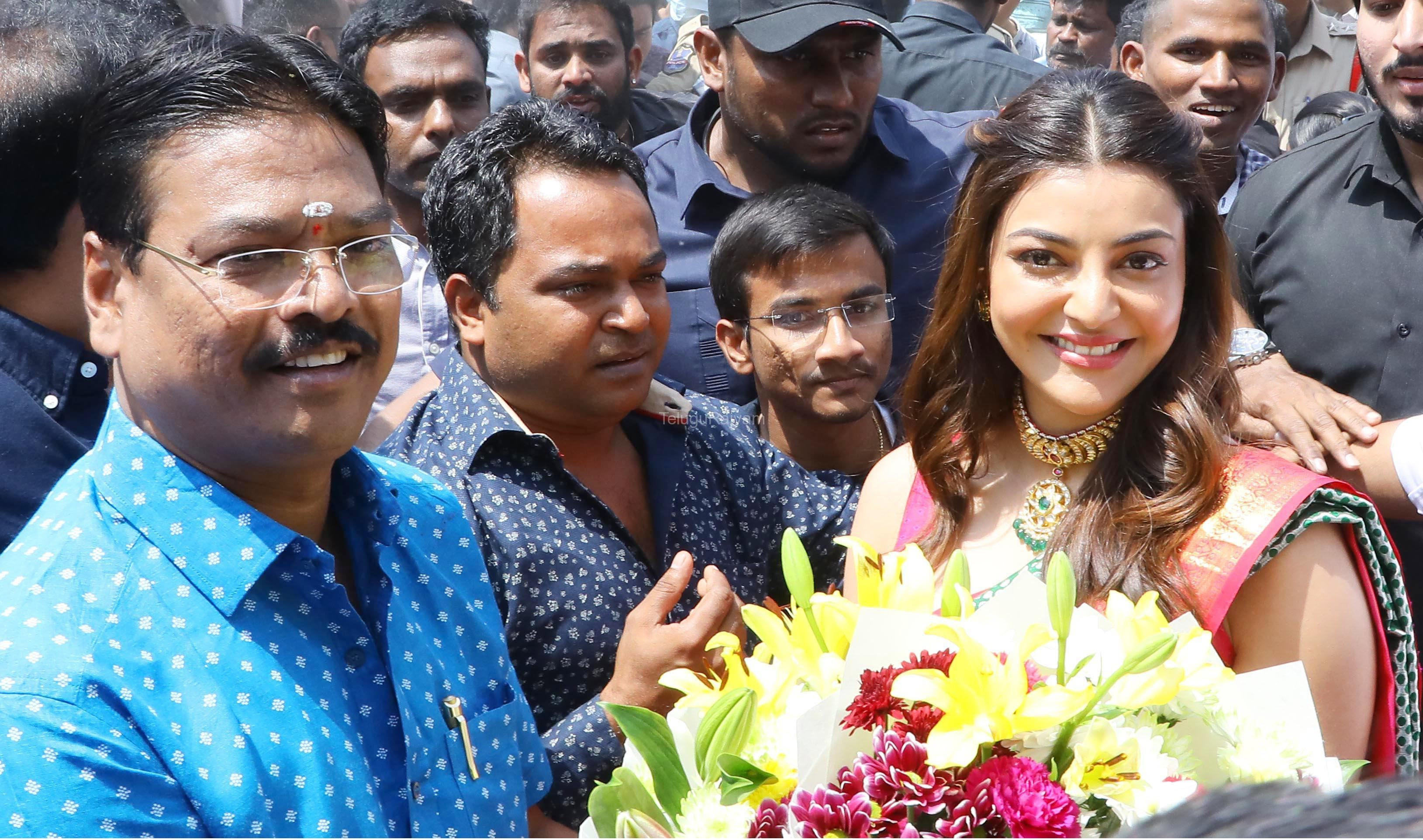 Mr Kasam Namashivaya, Chairman; presenting a bouquet to Star Actress Kajal Agarwal, at the inauguration of the 5th Maangalya Shopping Mall in Hyderabad at Chintal, today.